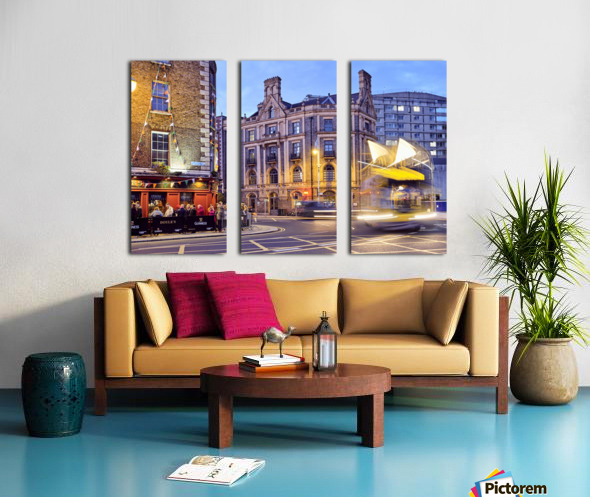 City street with people outside of pub at night Dublin Ireland Split Canvas print