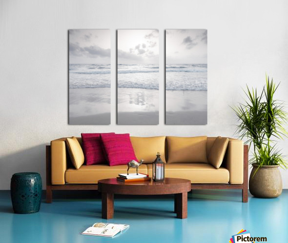 Tranquil beach with cloudscapes Split Canvas print