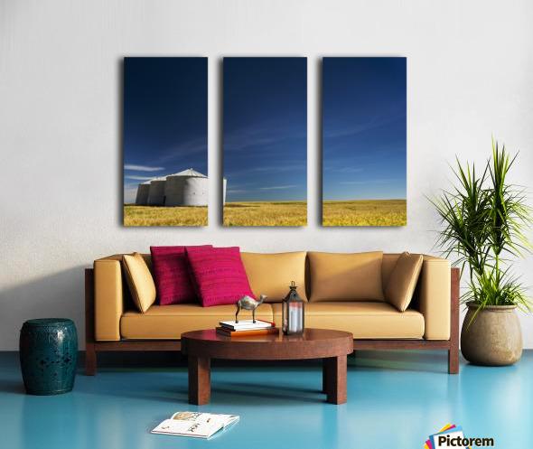 Large metal grain bins in a barley field with blue sky and wispy clouds; Acme, Alberta, Canada Split Canvas print