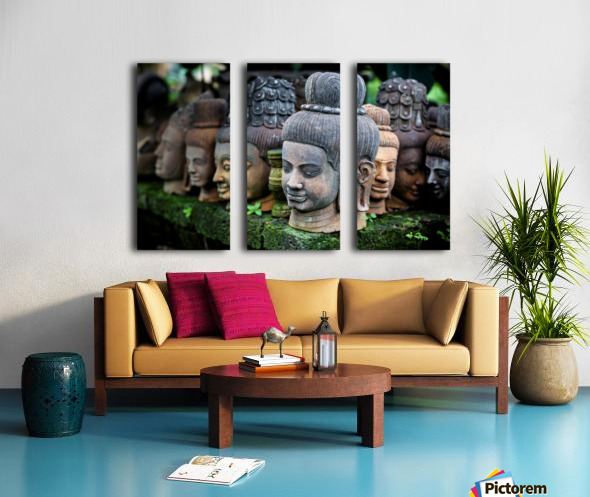 Heads of statues of Buddha are stacked in a terra-cotta factory; Chiang Mai, Thailand Split Canvas print