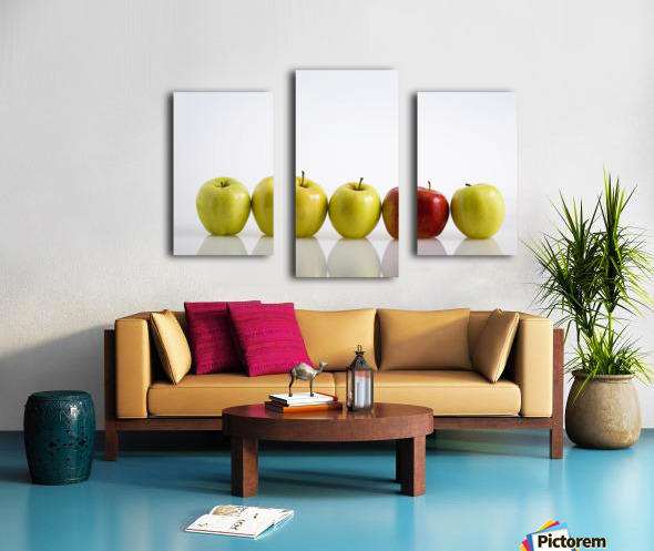 Four Yellow Apples With One Red Apple In A Row On A Reflective Surface; Calgary, Alberta, Canada Canvas print
