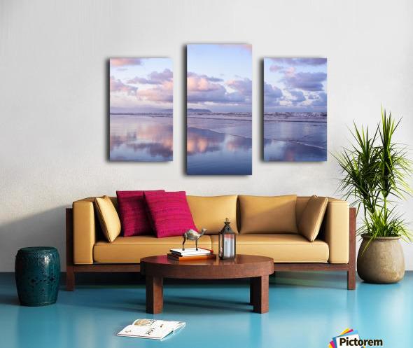 Clouds reflect on an Oregon beach at sunrise; Hammond, Oregon, United States of America Canvas print