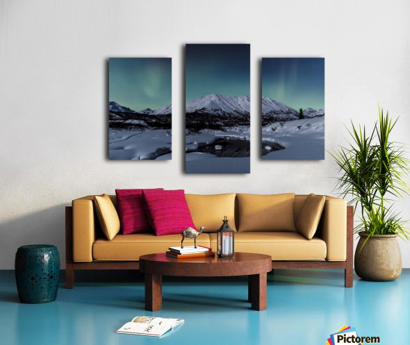 Aurora Borealis (Northern Lights) dance above Idaho Peak and the Little Susitna River at Hatcher Pass in winter, South-central Alaska; Alaska, United States of America Canvas print