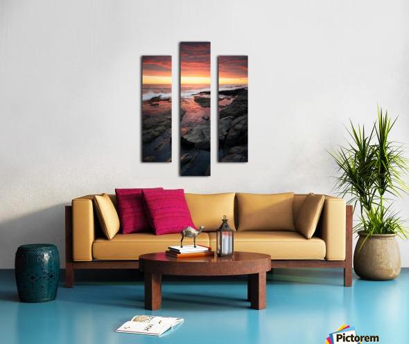 Sunset over rocky coastline Canvas print