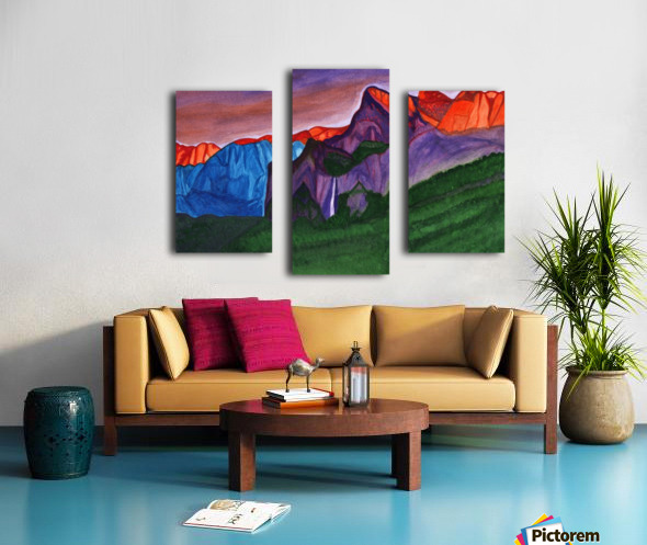 Snowy peaks of the mountains with a waterfall lit up by the orange dawn Canvas print