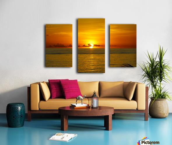 Sun rising on the ocean Canvas print