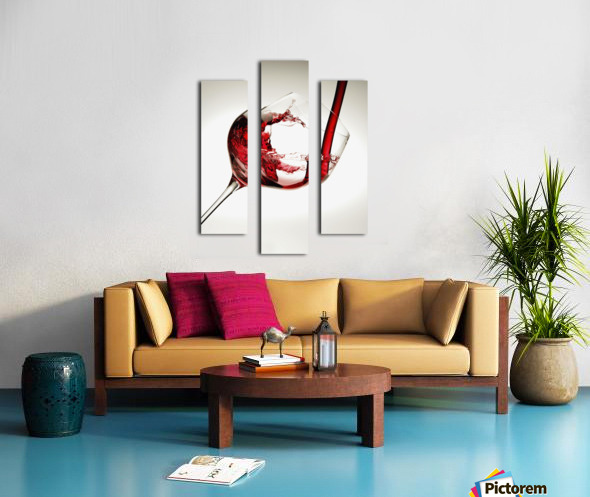 Red wine pouring into a glass Canvas print