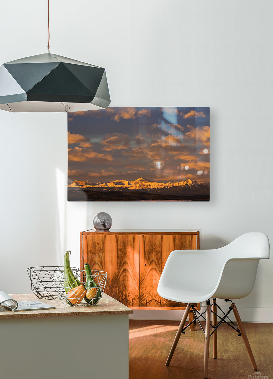 Glowing warmly lit snow covered mountain range and foothills with glowing clouds and blue sky at sunrise; Calgary, Alberta, Canada  HD Metal print with Floating Frame on Back