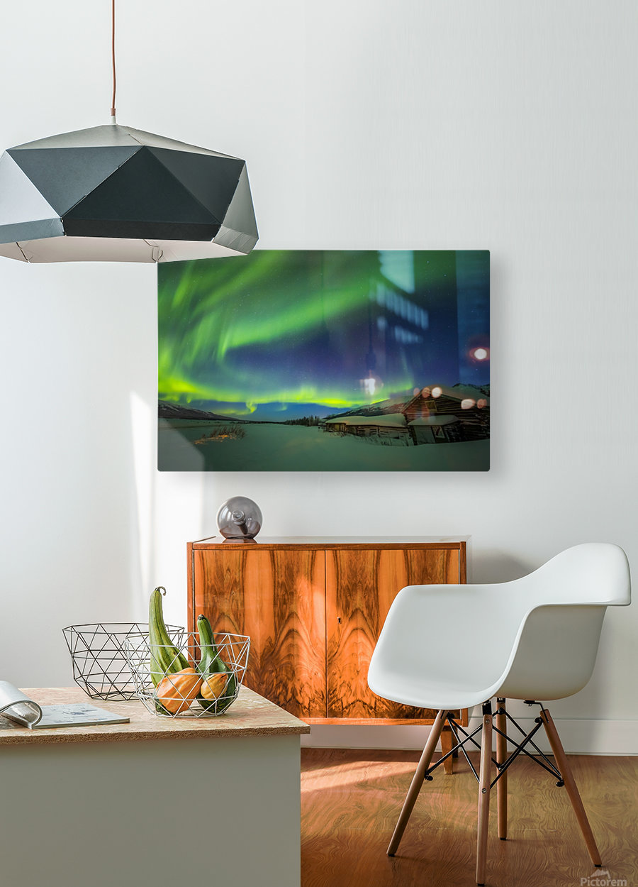 The aurora fills the sky above the historic Black Rapids Roadhouse along the Richardson Highway on a bitterly cold night; Alaska, United States of America  HD Metal print with Floating Frame on Back