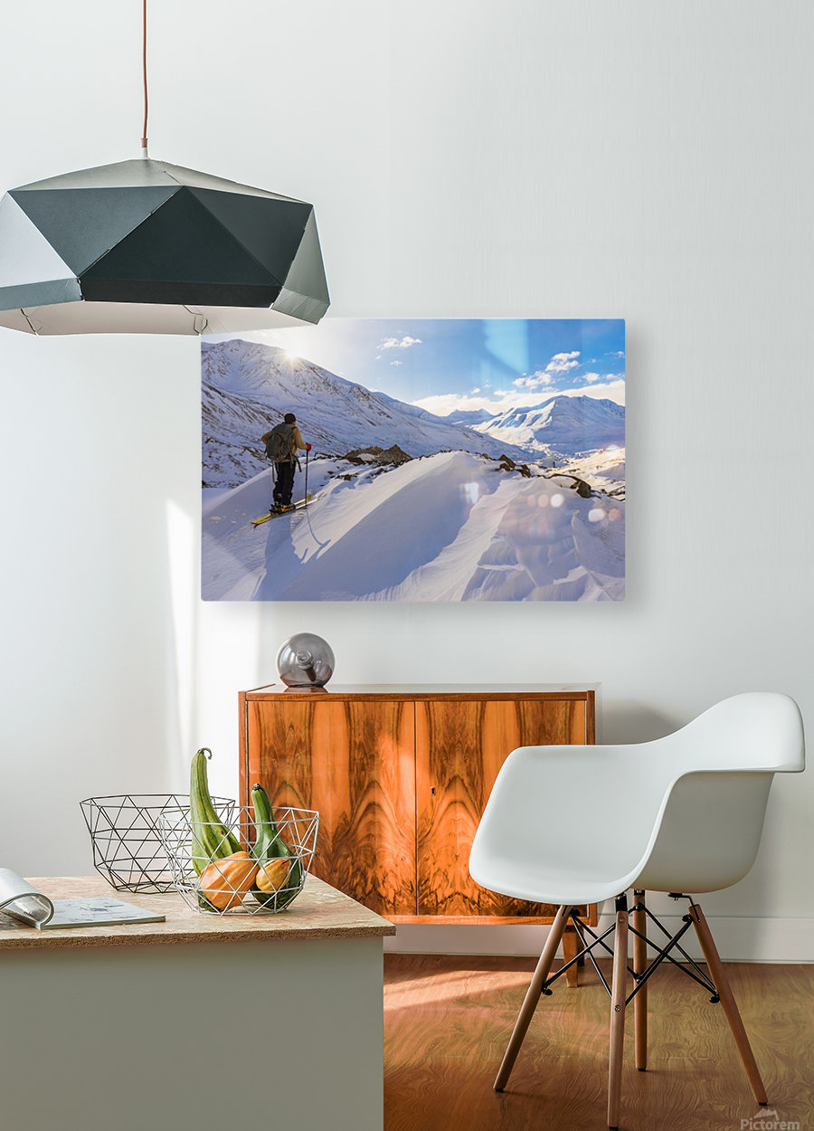 A backcountry skier looks over the Black Rapids Glacier valley from a high point on the terminal moraine in winter; Alaska, United States of America  HD Metal print with Floating Frame on Back