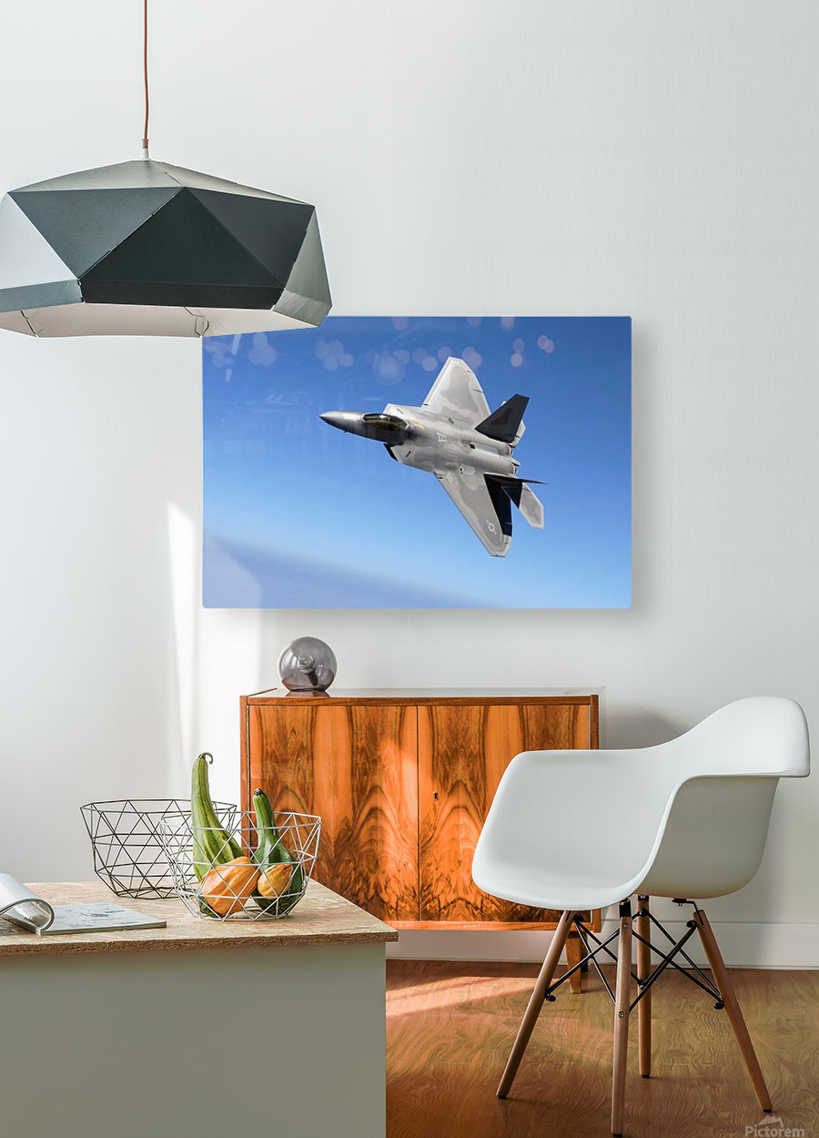 An F-A-22 Raptor banks during a training sortie.  HD Metal print with Floating Frame on Back
