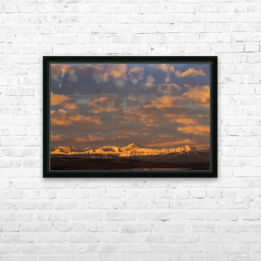 Glowing warmly lit snow covered mountain range and foothills with glowing clouds and blue sky at sunrise; Calgary, Alberta, Canada HD Sublimation Metal print with Decorating Float Frame (BOX)