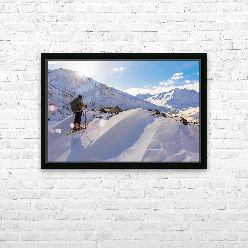 A backcountry skier looks over the Black Rapids Glacier valley from a high point on the terminal moraine in winter; Alaska, United States of America HD Sublimation Metal print with Decorating Float Frame (BOX)