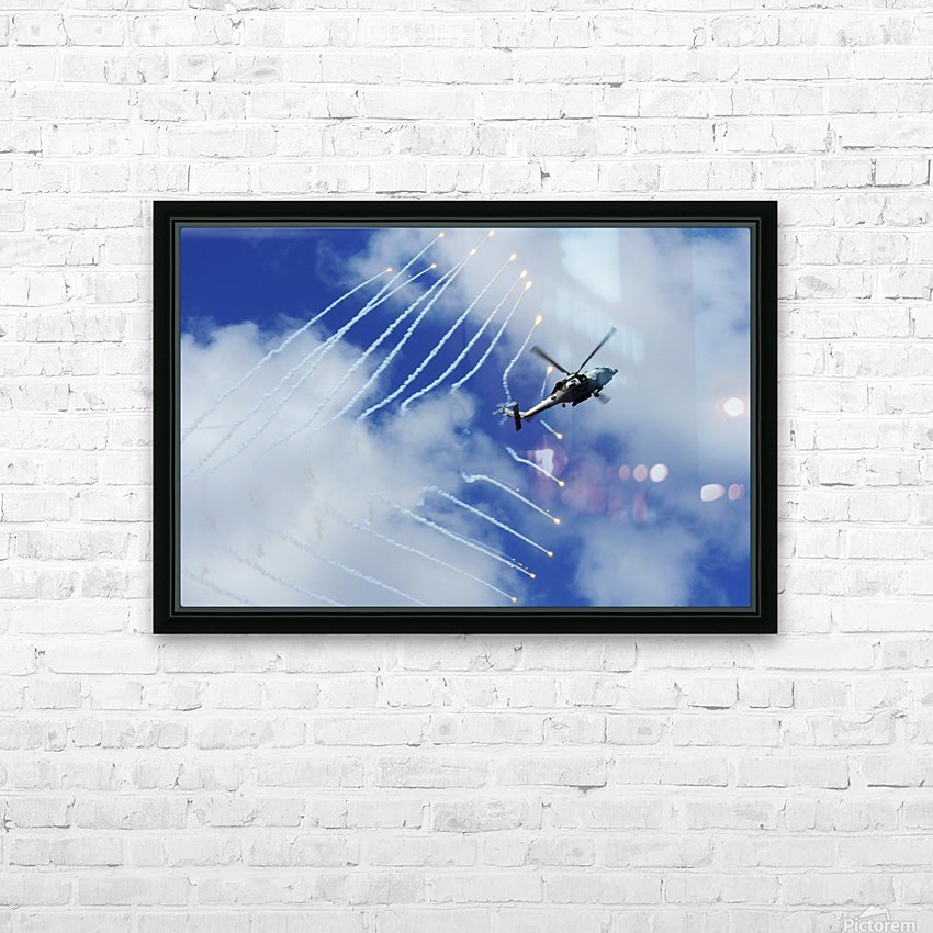 An HH-60H Sea Hawk helicopter releases countermeasure flares. HD Sublimation Metal print with Decorating Float Frame (BOX)