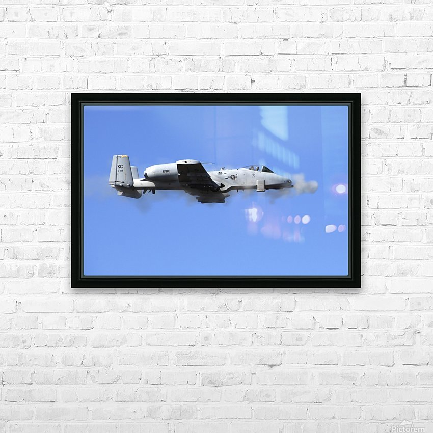 A pilot in an A-10 Thunderbolt II fires the planes 30-mm cannon. HD Sublimation Metal print with Decorating Float Frame (BOX)