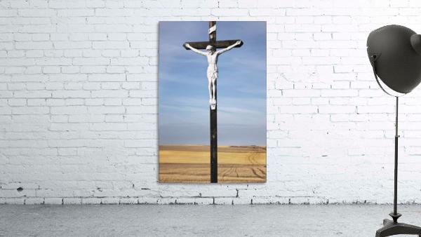 Crucifix and a farm field in the background;Saskatchewan canada