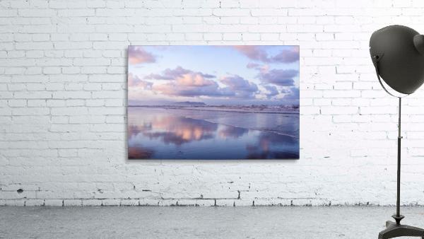 Clouds reflect on an Oregon beach at sunrise; Hammond, Oregon, United States of America