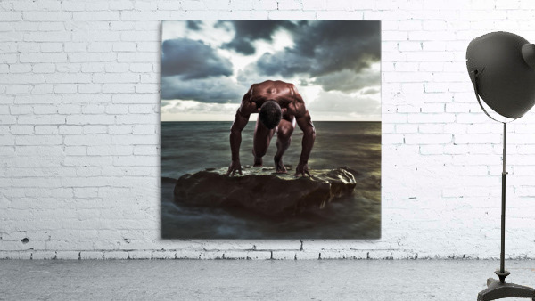 A muscular man in the starting position on a wet rock in the water;Tarifa cadiz andalusia spain