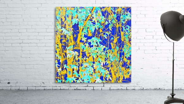 green maple tree leaf with blue and yellow abstract background