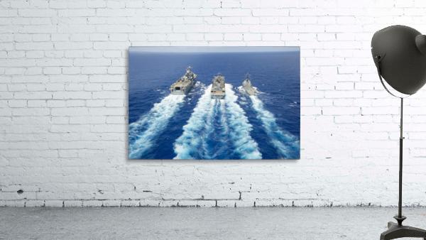 USS Peleliu and USS Spruance conduct a replenishment at sea with USNS Rainier.