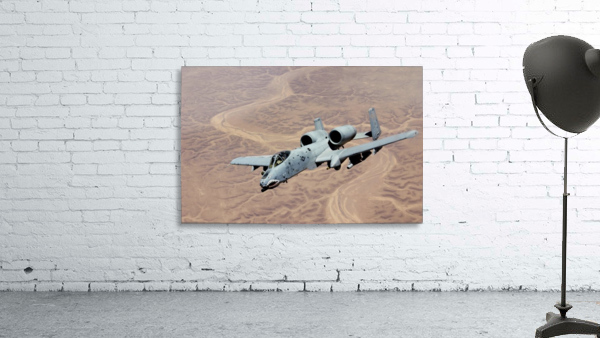 An A-10 Thunderbolt soars above the skies of Iraq.