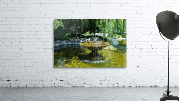 Refreshing Summer - the Little Fisherman Fountain Cheerfully Splashing in the Sunshine