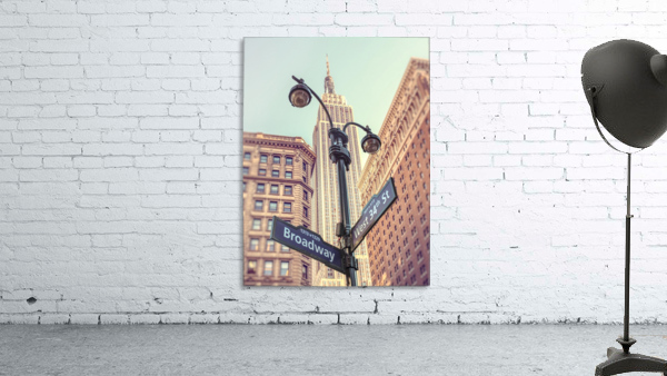 Street lamp and street signs with Empire State building in background - New York