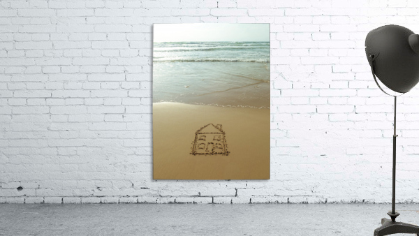 Sweet home drawn on sand at the beach