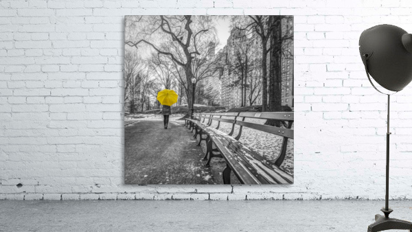Tourist on pathway with Yellow umbrella at Central park, New York