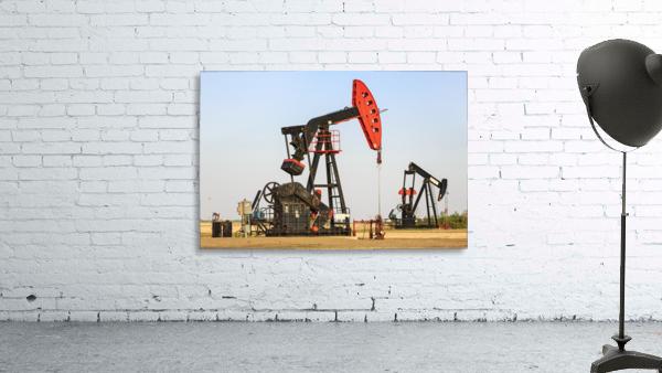 Oil well pump jacks at Bakken Oil Field near Estevan; Saskatchewan, Canada