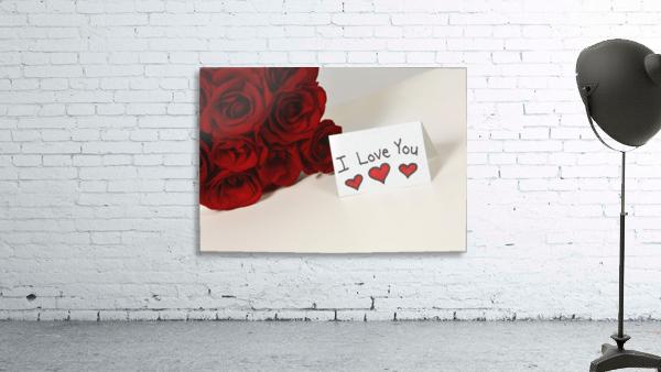 I Love You Card Beside Roses