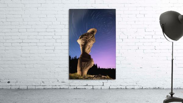 Light painting on monolith and star trails, Anse des Bonnes Femmes at Ile Niapiskau, Mingan Archipelago National Park Reserve of Canada, Cote-Nord, Duplessis region; Quebec, Canada