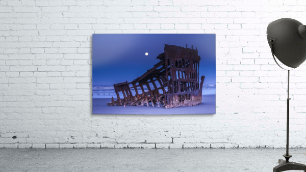 The moon sets over the wreck of the Peter Iredale; Oregon, United States of America