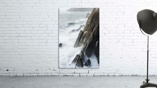Surf breaks on the rocks; Manzanita, Oregon, United States of America