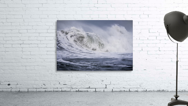 A large wave breaks on a stormy morning; Seaside, Oregon, United States of America
