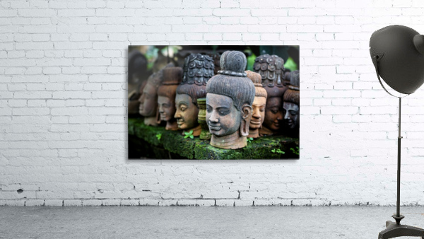 Heads of statues of Buddha are stacked in a terra-cotta factory; Chiang Mai, Thailand
