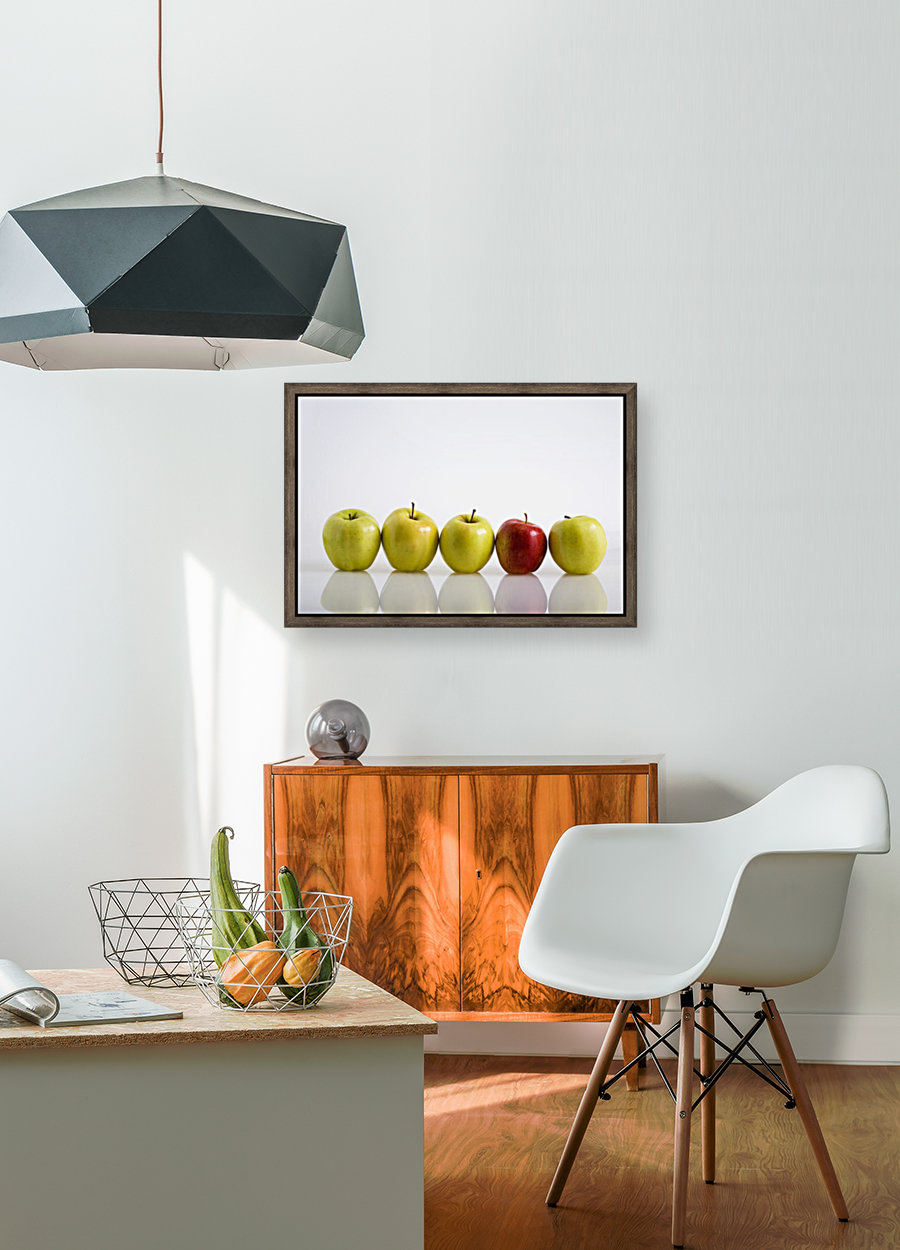 Four Yellow Apples With One Red Apple In A Row On A Reflective Surface; Calgary, Alberta, Canada  Art