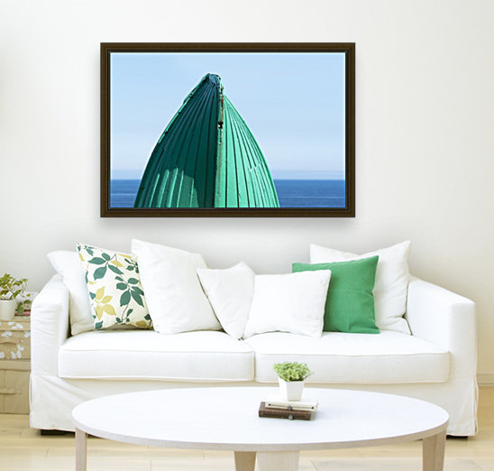 Close-up of  the bottom of the bow of a wooden boat painted green and the tranquil water and blue sky in the background; South Shields, Tyne and Wear, England  Art