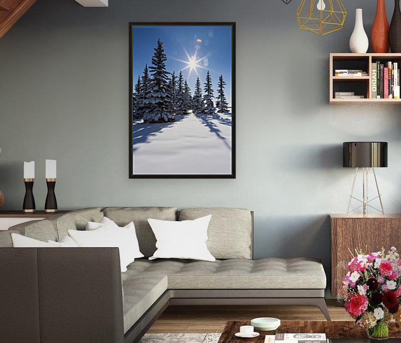 Snow covered evergreen trees on a snow covered hillside with blue sky and sun burst; Calgary, Alberta, Canada  Art