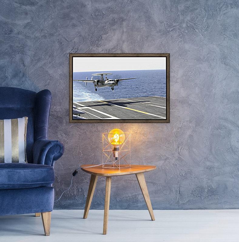 An E-2C Hawkeye makes its approach to the flight deck of USS Dwight D. Eisenhower.  Art