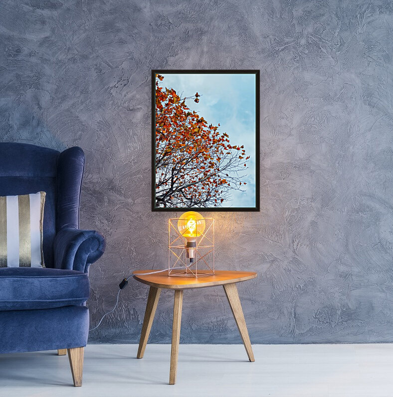 Tree branch with orange autumn leaves and blue cloudy sky  Art