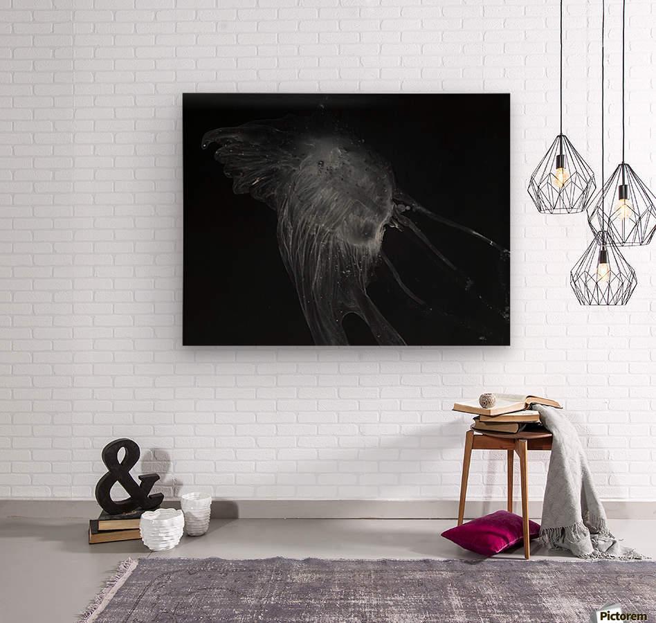 Glowing grey jellyfish in the dark water  Wood print