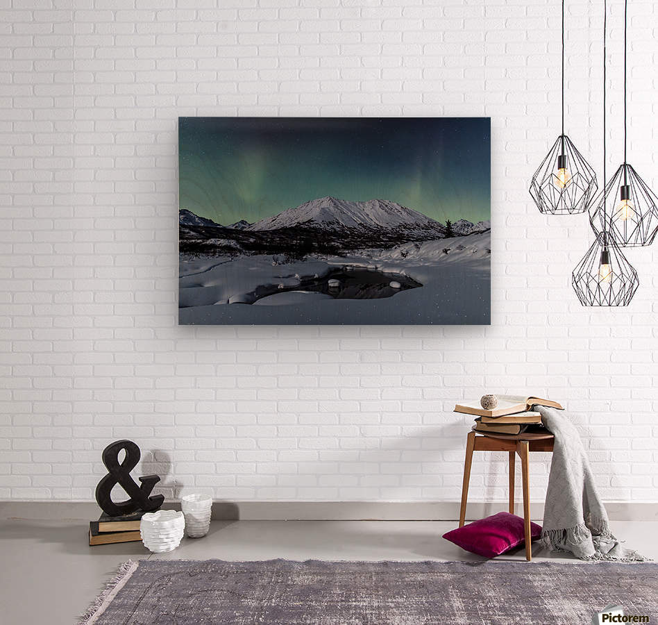 Aurora Borealis (Northern Lights) dance above Idaho Peak and the Little Susitna River at Hatcher Pass in winter, South-central Alaska; Alaska, United States of America  Wood print