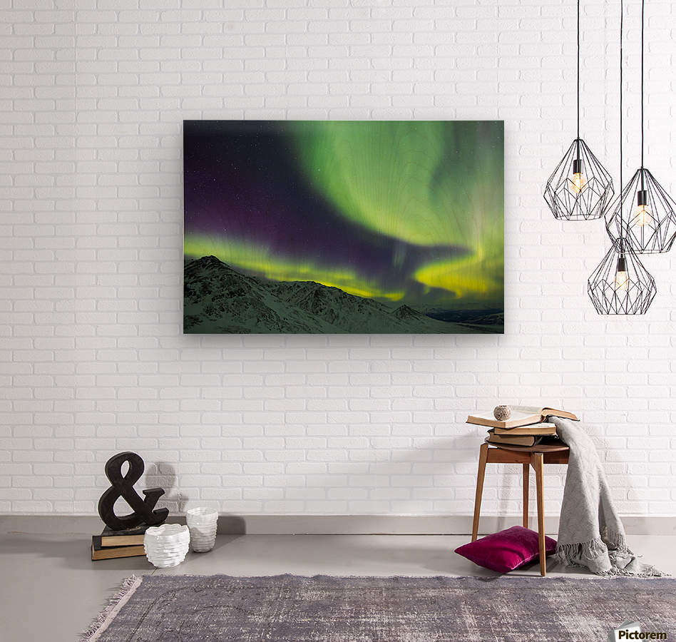 Aurora borealis swirls over mountains within Denali National Park on a very cold winter night; Alaska, United States of America  Wood print