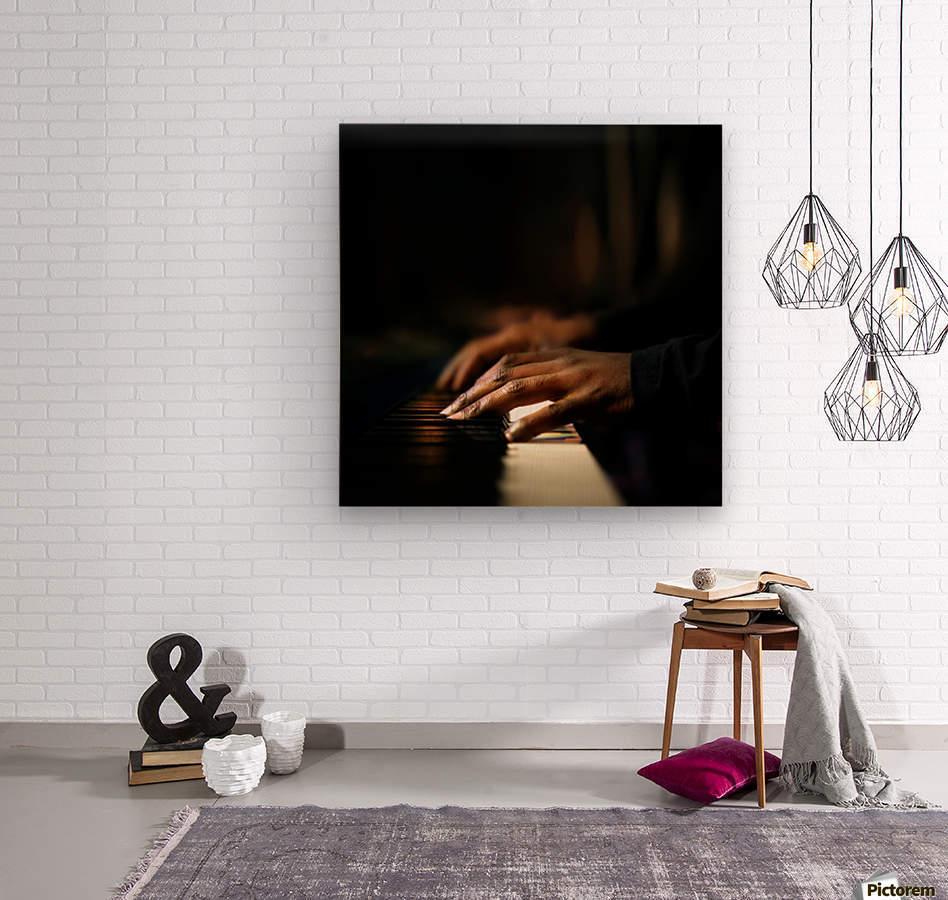Hands playing piano close-up  Wood print