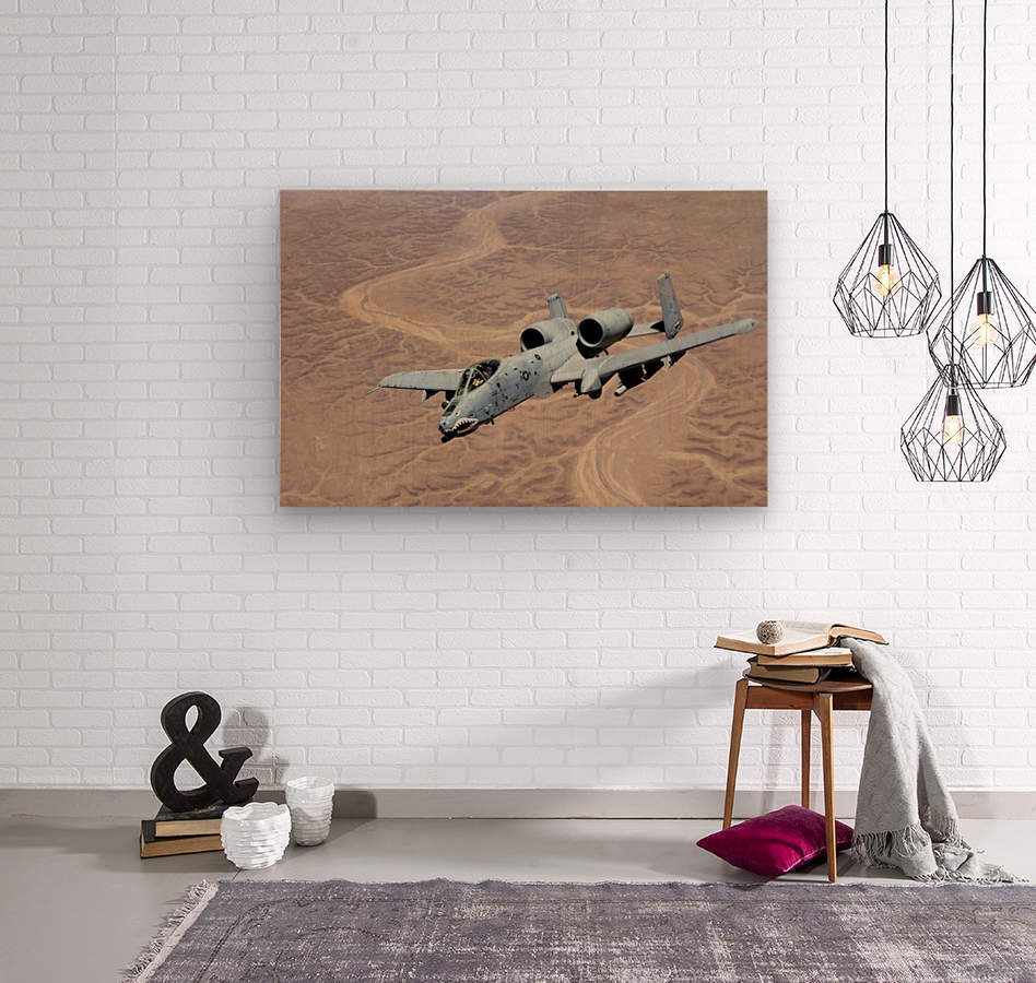 An A-10 Thunderbolt soars above the skies of Iraq.  Wood print