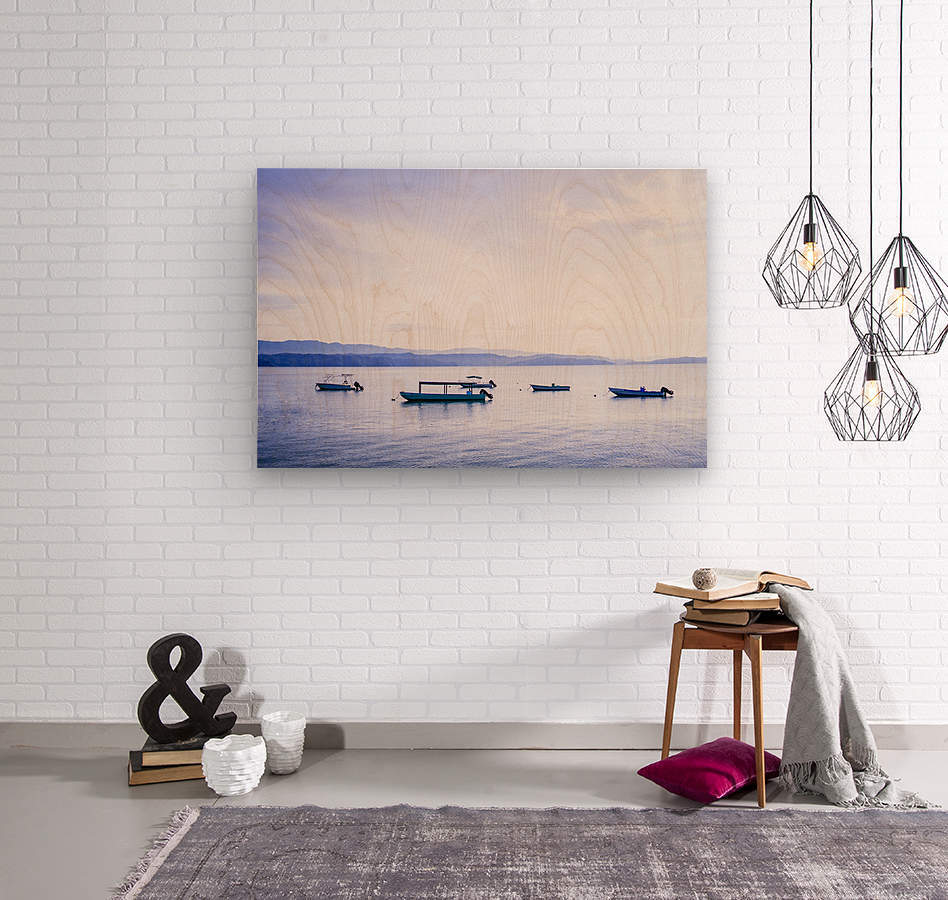 Sunrise in the Osa peninsula with boats in harbour  Wood print