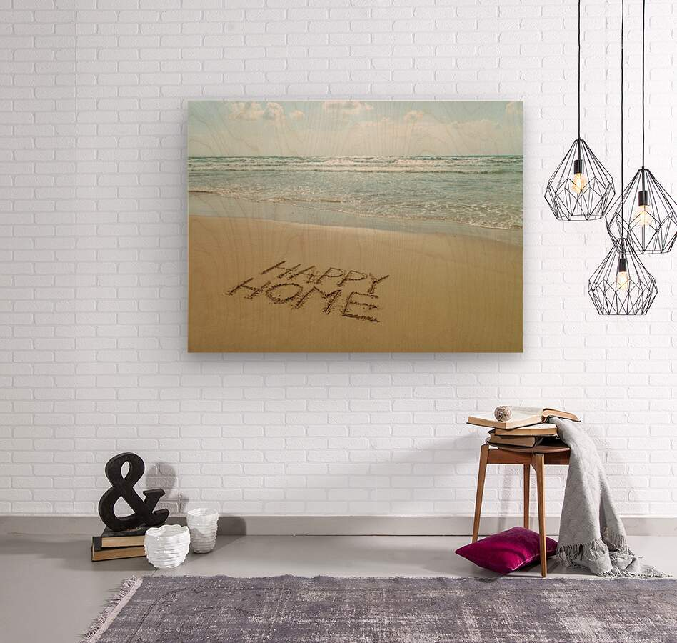 Happy Home written in sand on the beach  Wood print