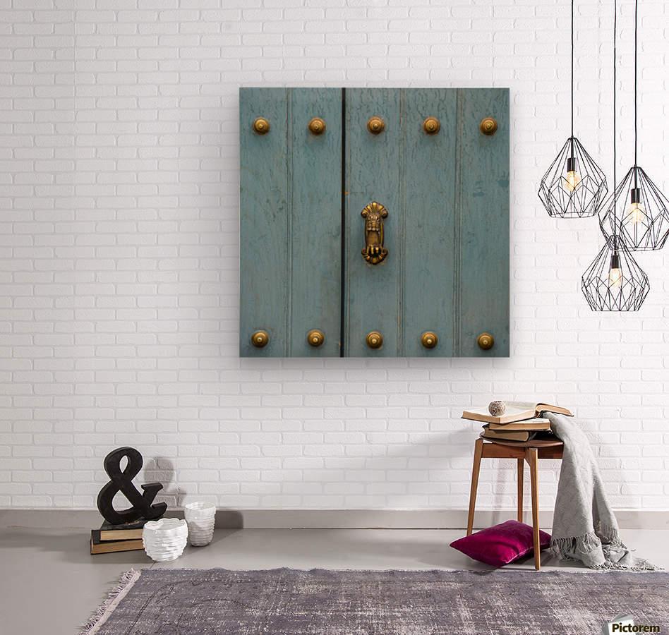 A Blue Door With Brass Decorative Knobs; Cusco, Peru  Wood print