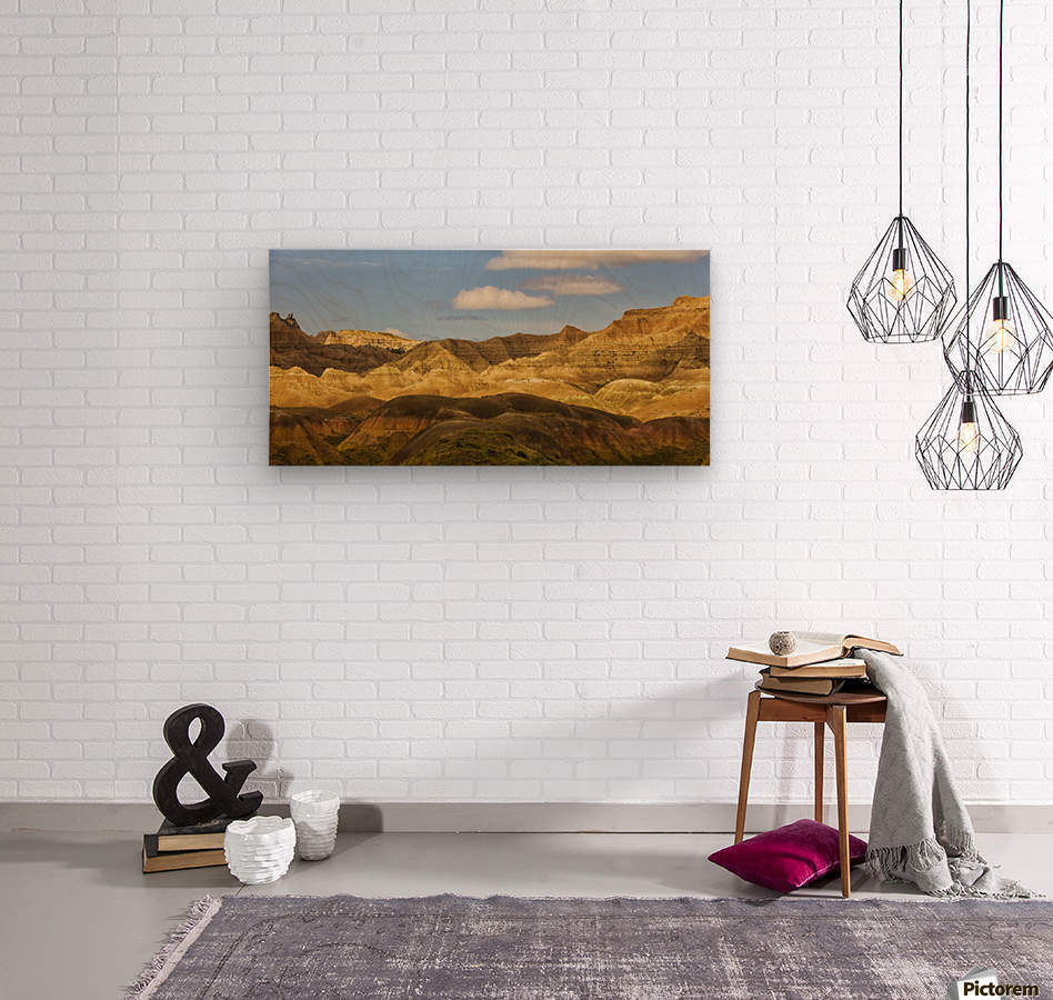 Dramatic light on the eroded formations of badlands national park; south dakota united states of america  Wood print